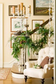 like the candles in the silver candleabra.   Holiday House Tour: At Home With Nell Hill's Owner | Midwest Living