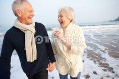 Stock Photo : Senior Couple Walking Along Winter Beach