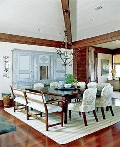 fun square dining table.  i'd like it better with mismatched chairs.