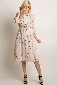 A polka dot print midi dress featuring a cinched elastic waistline, sleeves with cinched cuffs, and a high neckline with cutout tie front accent. Body is double lined to prevent sheerness. Retro Outfits, Mode Outfits, Skirt Outfits, Dress Skirt, Midi Dress With Sleeves, Maternity Midi Dress, Cute Maternity Outfits, Maternity Swimwear, Maternity Photos