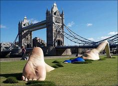 London Ink Swimmer - This 46-feet long and 10-feet high sculptures of a life-like swimmer swimming through the grass was commissioned by London Ink reality TV show.