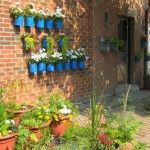 Tin can wall garden