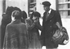 Lodz, Poland, A woman crying in the ghetto, apparently after saying farewell to a relative who was deported.