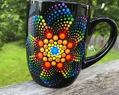 Beautiful dot mandala design in vibrant rainbow colors on a black ceramic mug. each mug is carefully hand-painted with non-toxic acrylic paint. Mandala Art, Mandalas Painting, Mandala Design, Dot Art Painting, Ceramic Painting, Stone Painting, Painted Mugs, Painted Rocks, Hand Painted