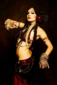 Pinning a bunch of awesome belly-dance costumes to get me motivated to start dancing again.