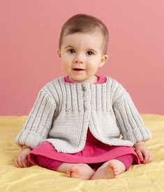Wrap your little one in a super soft cardi to keep away the cold! This swing-style cardigan features an adorable rib pattern. Best of all, the easy machine wash and dry care of Martha Stewart Crafts Extra Soft Wool Blend TM/MC makes caring for this sweater worry-free. (Lion Brand Yarn)