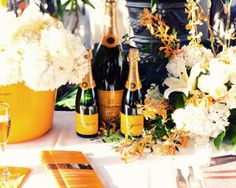 Veuve Clicquot Champagne with pretty flowers that go so well with the labels!