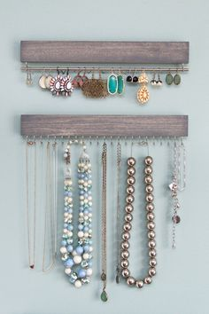 *Shown with a matching necklace rack, not included but available in a separate listing.*  Driftwood gray stained and waxed wood earring display with two hooks (either gold/brass or nickel) and a solid bar (either brass or silver) to hold earrings. 12 long by 2 tall (including hooks), 1/2 deep. The silver earring display carries a higher price than the display with brass hardware - the earring bar is more expensive in silver (real silver) than it is in brass.  Please keep in mind that grain…
