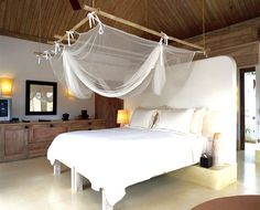 Mosquito netting a great addition to a beach themed bedroom
