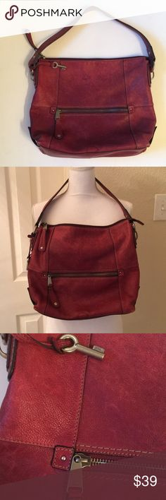 Fossil Leather Bag Gorgeous deep red Fossil slouchy Bag.  Has nice large zippered pocket in front, zipper top close(all zippers work perfectly).  Clean interior.  Additional zippered pocket + 2 open pockets inside.  As can be seen in the pictures, there is some watermark damage spots. One is on the front at the bottom & then a cluster of 3-4 on the back side- please review pictures.  Otherwise, great condition & quality Fossil Leather.  See pictures for measurements Fossil Bags Hobos