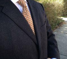 Navy suit, white shirt, light brown tie
