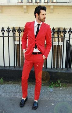 Mark Ronson in a beautiful red suit. Is that corduroy? He's just ...