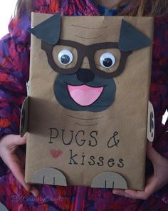 pugs and kisses valentine box made out of a recycled cheerios box and paper