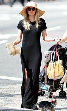0ddabcb1a2d Model Jessica Hart looks effortless in a black maxi + floppy hat.