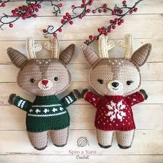 Reindeer wearing green and red sweaters and holly