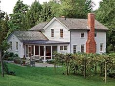 With a nod to agrarian buildings in the are, Murray chose a lead-coated copper roof for the farmhouse's porch.