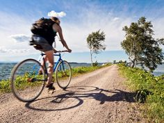 Vermont Beaches   cyclist pedals down the causeway at the end of Burlington's Bikepath ...