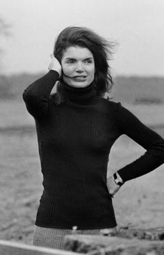 Jackie Kennedy in  1979 in a simple black turtleneck and trousers.