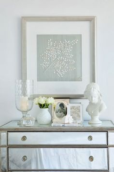I never really paid much attention to mirrored furniture until a beautiful mirrored chest was brought to my house during the recent livin. Bedroom Chest, Master Bedroom, Transitional Bedroom, Mirrored Furniture, Dresser With Mirror, Mirrored Dresser, White Vases, Boutique Design, House And Home Magazine
