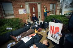 """December 2011: Activists storm House Speaker John Boehner's West Chester, Ohio office this morning with a """"human oil spill"""" in response to a vote to force through Keystone XL. The fossil fuel industry has poured an estimated $42,000,000 into campaign coffers of the 234 House members voting in favor, including $1,100,000 to Rep. Boehner alone, according to OpenSecrets.org. The industry lists the pipeline as a top priority."""