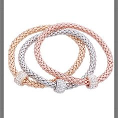"Tri Tone Slider Charm Stretch Bracelet Set Set includes three bracelets  9.4"" circumference with stretch. 14k white gold plated brass: 14k gold plated brass and 14k rose gold plated brass and Crystal. Brand New Silver & Co. Jewelry Bracelets"