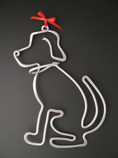 Aluminum wire shaped dog.  (I have some of this wire... could use it to make a variety of shapes, letters, etc.)