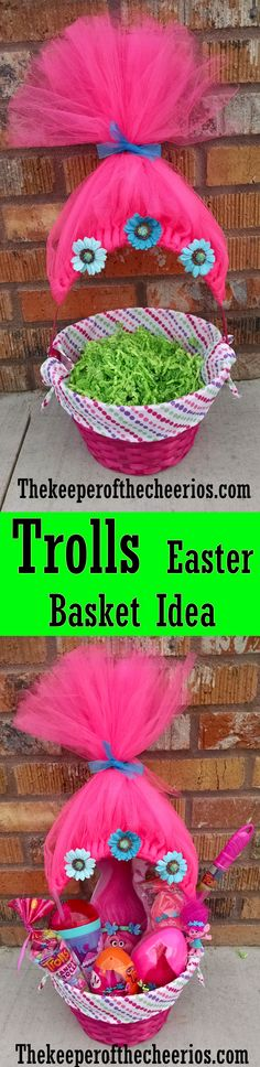 """Trolls Movie Easter Basket Idea Like most kids right now my daughter is crazy obsessed with the new Trolls Movie so for Easter this year I wanted to make her an extra special Trolls Easter basket (Poppy inspired hair). MATERIALS Basket Hot pink tulle(it takes one 6"""" x 25 yard roll) Bright blue ribbon Bright blue flowers (I used paper ones found in the scrapbook section of a craft store) Piece of cardboard scissors hot glue and glue gun Green basket filler Lots of fun troll stuff DIRECTI..."""