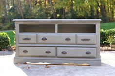 Five-drawer dresser with top two drawer spaces open- perfect for tv stand, buffet, storage... Tv receivers, dvd players, game consoles would fit perfect in the empty drawer spaces- dvd's, game controllers, blankets could be stored in drawers. All drawers are in great working condition. Painted a dark grey, distressed and waxed. The top is stained a walnut color.