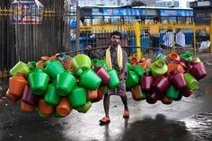 A man carries empty water pitchers for sale in a market in the southern Indian city of Bangalore October (REUTERS/Abhishek N. Most Popular Instagram, Like Instagram, Photo Instagram, Instagram Images, Pictures Of The Week, Weird Pictures, Great Photos, Funny Photos, The Things They Carried