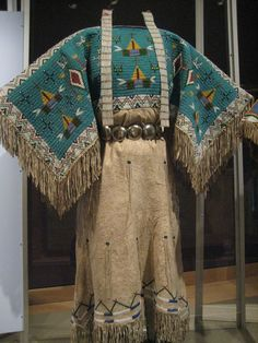 Yankton Dakota (Sioux) Two-Hide Pattern Dress with Fully Beaded Yoke Dress: c. 1940 South Dakota Hide, seed beads, sinew Item number: 20/2009