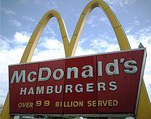 McDonald's sign showing number of burger served.  Changing ever 5 billion until reaching 100 billion.