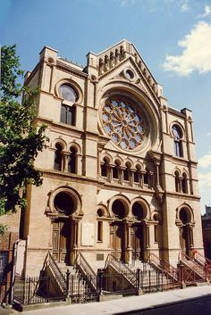 A National Historic Landmark located on the Lower East Side of Manhattan, Eldridge Street Synagogue was one of the first synagogues built in the United States by Eastern European Jews that is still open today. The synagogue underwent a period of abandonment in the 1950s through the 1980s, but has now become a public museum. Its renovation involved the cooperation of many different groups. - by acanyc, via Flickr