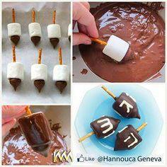 Pretzel sticks, marshmellows, kisses, chocolate and voila! Delicious dreidels!