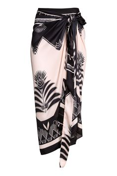 Sarong in airy, woven fabric with a printed pattern. Tie at each upper corner. Size 31 x 45 in., total length of ties 96 Fashion Night, Look Fashion, Skirt Fashion, Womens Fashion, Sarong Skirt, Dress Skirt, Sarong Wrap, Model Kebaya, Kebaya Dress