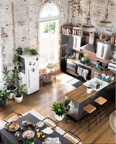 Converted warehouse makes for a stunning loft apartment. Exposed brick walls are… Converted warehouse makes for a stunning loft apartment. Exposed brick walls are soften with loads of indoor plants and timber furniture. Living Room Interior, Home Interior Design, Interior Decorating, Decorating Ideas, Decor Ideas, Living Rooms, Loft Apartment Decorating, Kitchen Interior, Interior Ideas