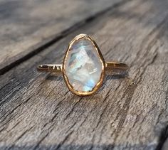 All natural rainbow moonstone, lightly faceted. Handmade gold filled open back bezel setting. Any size, made to order. Moonstone: 10x7mm Moonstone