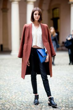 brick-coloured coat, boho top, black skinny's and backless boots