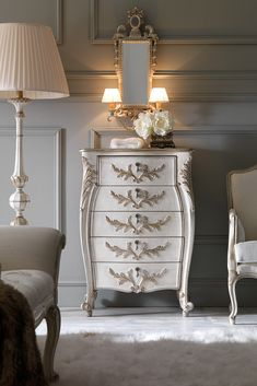 Shown here in an antique white finish together with hand painted antiqued silver and ash. Embellished with unique delicate handle fittings with tear drop ceramic pulls. Find the Ornate Carved Italian Narrow Chest of Drawers at Juliettes Interiors. The most stunning of additions to any room in the house. A glamorous chest of drawers for any setting, the ultimate in stylish storage solutions. Truly versatile.