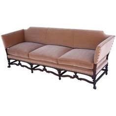 One of Two Custom Walnut Spanish Revival Sofas | From a unique collection of antique and modern sofas at https://www.1stdibs.com/furniture/seating/sofas/