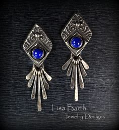 Here is a little pair of ear rings I made with silver metal clay.  They have 6 mm Lapiz cabs bezel set and sterling paddles that dangle and catch the light when worn.-- Lisa Barth