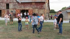 Guests at the church party dance the Virginia Reel in the large Barn Courtyard at the Civil War Ranch. Wedding Barn is in the background. (Pictures by Lena & Leif Baron)
