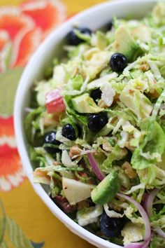 Shaved Brussels Sprouts Salad with walnuts, blueberries and zesty vinaigrette