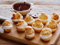 Cooking Channel serves up this Cream-filled Profiteroles with Chocolate Sauce…