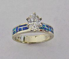 $1,480.00  14 Karat White Gold Engagment Ring With Lab Opal and 1/2 Carat Oval Diamond