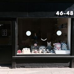 Annual kids concept store in Lincoln, UK. Cute shopfront with smiley face. Lucky Boy Sunday knitted and soft dolls.