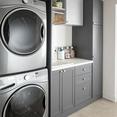 laundry room design, white laundry room with laundry room storage, laundry room organization with neutral floor tile, neutral mudroom design with laundry and folding counter and laundry sink Modern Laundry Rooms, Laundry Room Layouts, Laundry Room Remodel, Laundry Room Cabinets, Farmhouse Laundry Room, Laundry Closet, Laundry Room Organization, Basement Laundry, Diy Cabinets