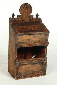 Attributed to Connecticut late 18th Century Pine.   Open candle or salt box with lift lid on top compartment.  Shaped crest and applied molding.  Traces of old black paint.  Imperfections  Garths Auction