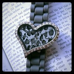 NWOT Gray Leopard Heart Watch New listing!! NWOT Charming Charlies gray rubber band heart watch. Has a leopard like print adorned with rhinestones around the heart. Excellent condition no rhinestones missing just needs a new battery, even though I never wore it. Charming Charlie Accessories Watches