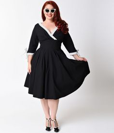 Is there any other like Diana, darlings? An enchanting black plus size dress that radiates 1950s vintage charm, boasting a pleated surplice v-neckline, three-quarter sleeves with darling bow tie detail and a thick banded natural waistline. An ample A-line