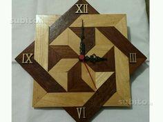 Orologio da parete in legno pregiato